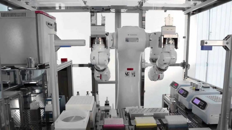 Motoman dual arm robot in biomedical cell