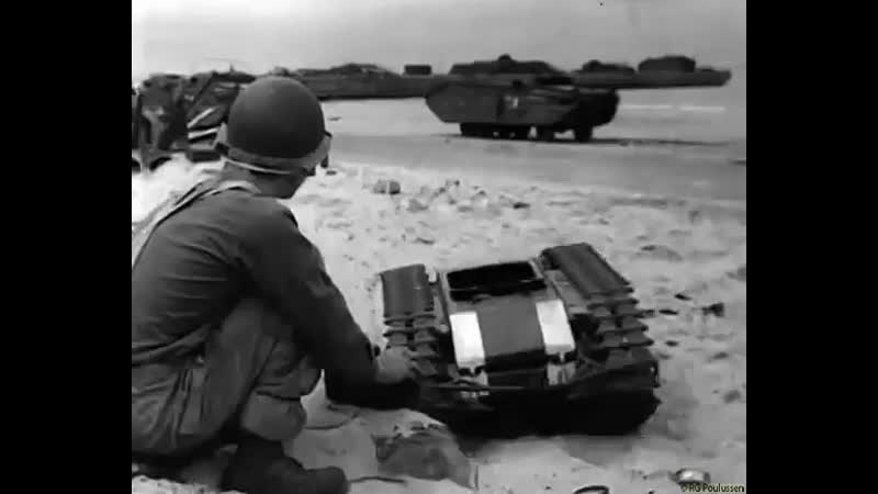 1944, Normandy. On the beach, you play with the things you find German Leichter Ladungsträ.mp4