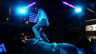 Man Dances on Mechanical Bull Wearing Best Sunday Suit