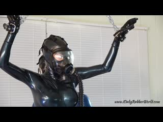 Girl and boy latex catsuit in gas mask