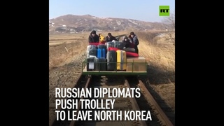 Russian diplomats push trolley to leave North Korea