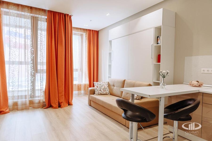 Интерьер квартиры почти 30 м (без учета лоджии) в Москве с откидной кроватью-диваном.