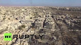 Syria: Drone captures devastated Damascus suburb